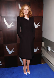 Nicole Kidman offset her black ensemble with white pumps.