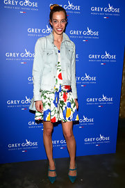 Micol Sabbadini chose a light-wash denim jacket to pair over her floral frock.