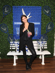 Sara Sampaio attended the Grey Goose #HoneyDeuce Season event wearing a black shawl-collar cardigan and leather skinnies.