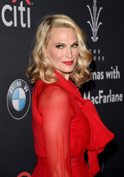 Molly Sims styled her blonde locks in loose curls with a side-part that highlighted her face at The Grove Christmas event.