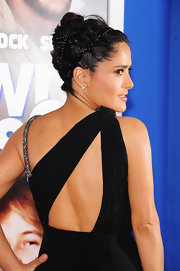 Salma rocked a modern French twist that featured braids and twisted details.