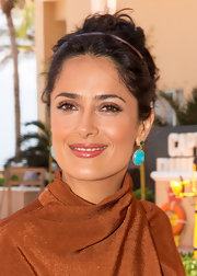 Salma chose a deep pink lip gloss to top of her natural-looking daytime look.