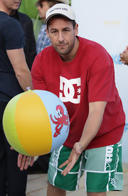Adam Sandler showed off a baseball cap at the Germany premiere of 'Grown Ups'.