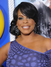 Niecy donned matching blue chandelier earrings with her alligator print cocktail dress.