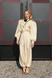 Chloe Sevigny looked funky in an oversized yellow ruffle blouse by Gucci during the label's Fall 2018 show.
