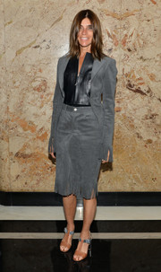 Carine Roitfeld chose a pair of brown and silver T-strap sandals to complete her look.