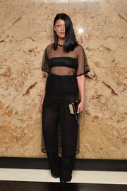 Crystal Renn layered her dress over a pair of black wide-leg trousers.