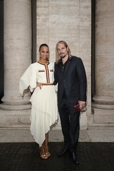 Zoe Saldana donned a white Gucci dress with flutter sleeves and an asymmetrical skirt for the brand's Cruise 2020 show.