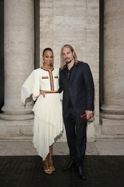 Zoe Saldana styled her dress with a pair of studded T-strap sandals, also by Gucci.