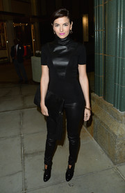 Camilla Belle completed her all-black ensemble with a tasseled suede clutch.