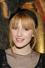 Bella Thorne rocked a messy top knot during the Guess and Harper's Bazaar dinner.