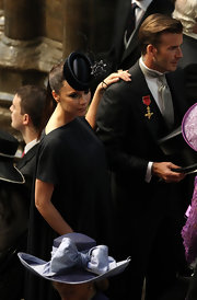 Victoria looked spectacular at the royal wedding in a dramatic black headpiece.