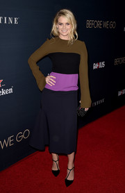 Alice Eve pulled her look together with a black Jimmy Choo clutch adorned with white beading.