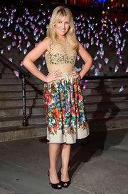 Ari Graynor chose this cool frock, which featured a sheer lace bodice and a floral printed skirt, for her look at the Vanity Fair Tribeca Film Festival Party.