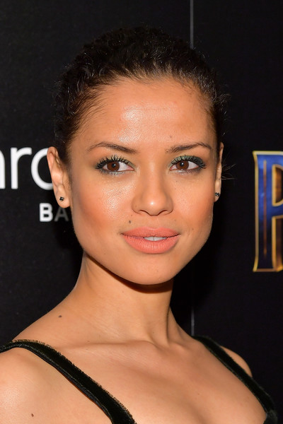 Gugu Mbatha-Raw Classic Bun [cinema society hosts a screening,black panther,hair,face,eyebrow,hairstyle,lip,chin,forehead,beauty,skin,cheek,gugu mbatha-raw,screening,new york city,marvel studios,the cinema society]