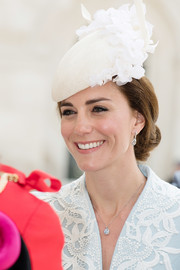 Kate Middleton paired her earrings with a matching diamond pendant.