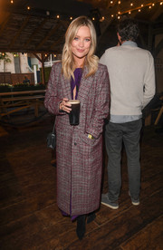 Laura Whitmore bundled up in a purple plaid coat for the 'Liberty Fields' documentary launch.