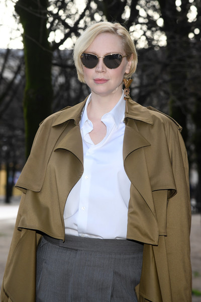 Gwendoline Christie Floating Lens Sunglasses [eyewear,clothing,white,sunglasses,street fashion,fashion,coat,outerwear,trench coat,yellow,louis vuitton,gwendoline christie,front row,part,paris,france,paris fashion week,show,louis vuitton menswear fall]