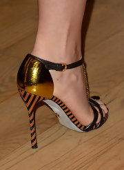 Gwyneth Paltrow added just a bit of fun to her black-and-white look when she chose these gold striped heels.