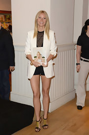 Gwyneth pared down her leggy look with a sophisticated white blazer.