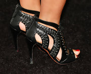Tracee Ellis Ross' black ankle booties had a touch of edge to them with their lace-up design and strappy cutouts.