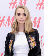 Cara Delevingne styled her hair with a slight wave and flippy ends for the H&M Westfield World Trade Center opening.