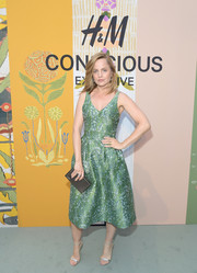 Mena Suvari continued the elegance with a pair of silver ankle-strap sandals.