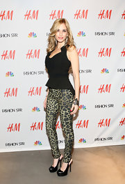 Luciana Scarbello dared to wear green leopard print pants to the H&M 'Fashion Star' celebration.