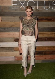 Kate Mara teamed her print blouse with embroidered nude silk pants, also from H&M Conscious Collection.