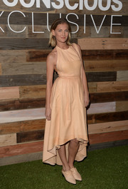 Elizabeth Von Guttman was edgy yet feminine in a nude fishtail halter dress during the H&M Conscious Collection dinner.
