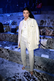 Sofia Richie went for a mannish vibe in an oversized white utility jacket during the H&M fashion show.