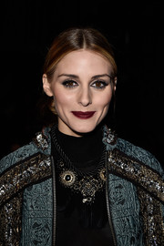 Olivia Palermo was bold with her beauty look, wearing dark red lipstick and heavy eyeliner.