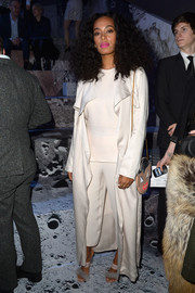 Solange Knowles arrived for the H&M fashion show wearing a white duster coat from the brand.