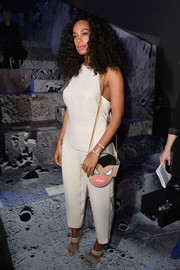 A face-print shoulder bag rounded out Solange Knowles' playful accessories.