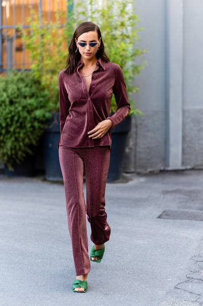 Irina Shayk was spotted during Milan Fashion Week wearing a burgundy button-down by H&M.