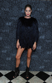 Doutzen Kroes' mid-calf peep-toe boots were a sexy complement to her baggy LBD at the H&M and Vogue Studios Between the Shows party.