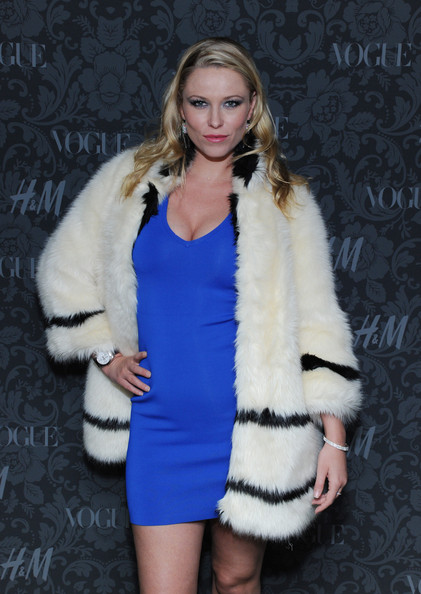 Kiera Chaplin glammed it up in a white fur coat with black stripes at the H&M and Vogue Studios Between the Shows party.