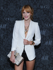 Bella Thorne topped off her ultra-chic ensemble with a boxy snakeskin clutch when she attended the H&M and Vogue Studios Between the Shows party.