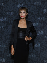 Zoe Kravitz was minimalist-chic in a black blazer layered over an LBD at the H&M and Vogue Studios Between the Shows party.