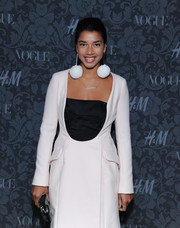 Hannah Bronfman finished off her look in fun style with a pair of dangling white pompom earrings when she attended the H&M and Vogue Studios Between the Shows party.