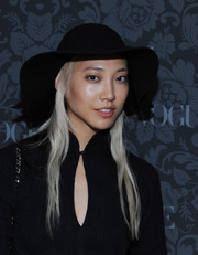 A floppy black hat added a feminine touch to Soo Joo's all-black ensemble at the H&M and Vogue Studios Between the Shows party.