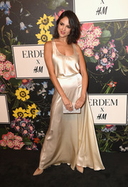 Eiza Gonzalez looked sultry in an ivory satin tank top at the Erdem x H&M runway show.