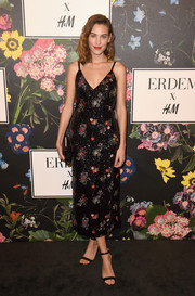 Alexa Chung went for minimal styling with a pair of black ankle-strap heels.