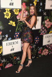 Barbara Palvin was retro-chic in a floral mini dress with waist cutouts at the Erdem x H&M runway show.