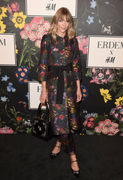 Jaime King showed off her vibrant fall style with this floral coat at the Erdem x H&M runway show.