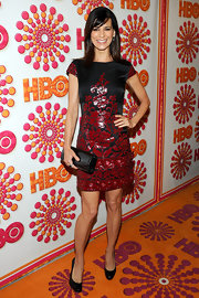 Perrey Reeves chose a lovely black gemstone cocktail ring to complement her shimmering red and black dress.