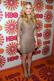 Leven Rambin accessorized her lacy cocktail dress with patent leather taupe platform pumps.