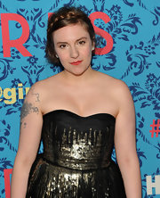 Lena Dunham arrived at the premiere of 'Girls' wearing a sparkly pair of pave diamond stud earrings.