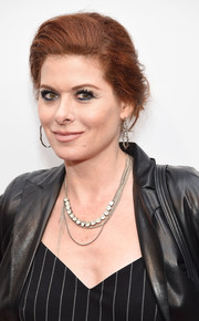 Debra Messing styled her hair into an elegant loose bun for the screening of 'I Am Evidence.'