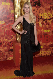 Emma Roberts complemented her dress with a black fur clutch by Emm Kuo.